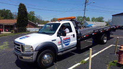 Picture of our white flatbed tow truck that is used for Northgate Towing in Cincinnati, OH